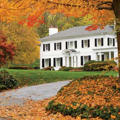 Beautiful home with colorful leaves in the fall season