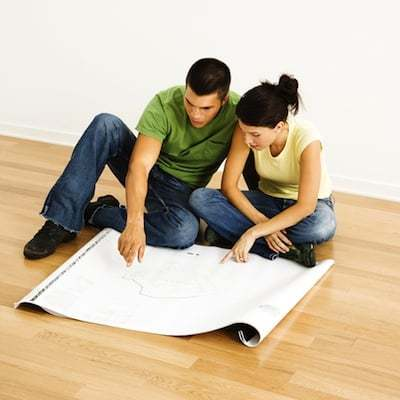 couple discussing about home renovation with home plan