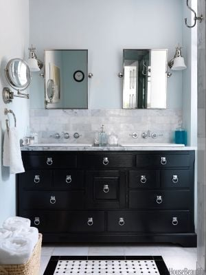 Small bathroom renovated with black and white background